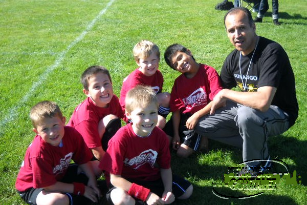 Venancio Gonzalez coaching soccer team