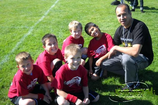 Venancio Gonzalez coaching soccer team
